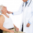 Doctor examing mouth of elderly man — Stock Photo