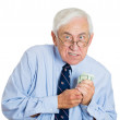 Mature man holding dollar banknotes — Stock Photo