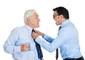 Angry worker grabbing mature boss by tie yelling screaming — Stock Photo