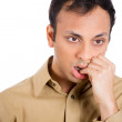 Closeup portrait of handsome man in brown shirt with fingers in mouth looking pathetic and beaten down — Stock Photo