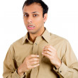 Closeup portrait of guy in brown shirt looking stunned and shocked in disbelief and disgust — Stock Photo #36295333