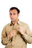 Closeup portrait of guy in brown shirt looking stunned and shocked in disbelief and disgust — Stock Photo