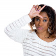 Closeup portrait of young woman displaying loser sign on her forehead and looking at you camera with disgust — Stockfoto