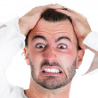 Closeup portrait of angry, unhappy, frustrated, stressed young man, pulling his hair out — Stock Photo #36365107