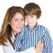 Closeup portrait of happy attractive mother and handsome son smiling — Stock Photo