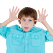 Stock Photo: Closeup portrait of adorable kid in blue shirt sticking out tongue at you camergesture thumbs hands on temple