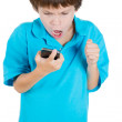 Closeup portrait of screaming, angry, young kid on the mobile phone — Stock Photo #36474271