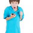 Closeup portrait of screaming, angry, young kid on the mobile phone — Stock Photo