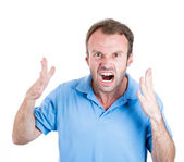 Closeup portrait of angry upset young mad guy, worker, employee, business man in blue shirt with hands up at you camera gesture — Stock Photo