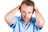 Closeup portrait of angry, unhappy, frustrated, stressed young man, pulling his hair out — Stock Photo