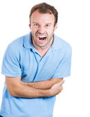 Closeup portrait of young man, screaming guy, doubling over in very bad stomach pain — Stock Photo