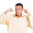 Closeup portrait of shocked and surprised handsome young man eyes wide open, hands fists in air — Stock Photo