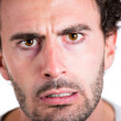 Closeup, cropped portrait of middle-aged man unhappy, worried and very troubled about something, having a desperate and crazy look in his eyes. — Stock Photo