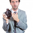 A close-up portrait of a shocked, surprised speechless man, businessman holding an empty wallet — Stock Photo