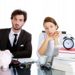 Closeup portrait of attractive anxious couple, man and woman, sitting looking distressed from financial problems and mounting bills — Stock Photo