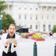 Stock Photo: Closeup portrait of happy, excited corrupt politiciin washington dc, holding dollar bills isolated on Capitol building background