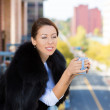 Closeup portrait of beautiful, happy, relaxed woman enjoying a weekend on sunny day, on balcony of her apartment, holding cup of coffee — Stock Photo