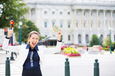 Closeup portrait of happy, excited corrupt politician in washington dc, holding dollar bills — Stock Photo