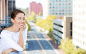 Closeup portrait of beautiful, happy, relaxed woman enjoying a weekend on sunny day, on balcony of her apartment — Stock Photo