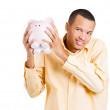 Closeup portrait of rich, happy, excited young successful man introducing his friend, the piggy bank — Stock Photo