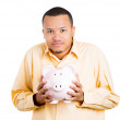 Stock Photo: Closeup portrait of rich, happy, excited young successful mintroducing his friend, piggy bank