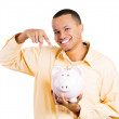 Stock Photo: Closeup portrait of excited young successful happy mstudent introducing his friend, piggy bank