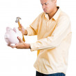 Closeup portrait of stressed, upset, sad, unhappy young adult man smashing piggy bank to get money — Stock Photo