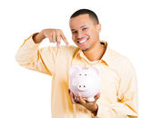 Closeup portrait of excited young successful happy man student introducing his friend, the piggy bank — Stock Photo