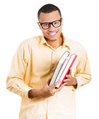 Closeup of a young handsome happy man, wearing big glasses, holding books, anxious in anticipation of finals, exam test — Stockfoto