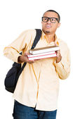 Closeup of a young handsome man, wearing big glasses, holding books, anxious in anticipation of finals, exam test — Photo
