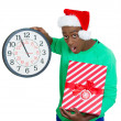 Closeup portrait of worried young man wearing red santa claus hat, holding clock and gift in hands — Stock Photo #37401217