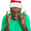 Closeup portrait of mean, mad guy, stressed man in red santa claus hat, yelling, very annoyed, unhappy — Stock Photo