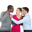 Stock Photo: Closeup portrait of two men fighting over womcaught in middle