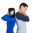 Closeup portrait of couple, man woman standing with backs together, covering ears, closed eyes, not listening to each other — Stock Photo