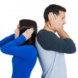 Closeup portrait of couple, man woman standing with backs together, covering ears, opened eyes, not listening to each other — Stock Photo