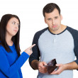 Closeup portrait of young couple. Handsome man holding empty wallet, feels guilty for reckless spending, woman mad about it — Stock Photo