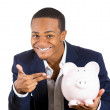Stock Photo: Closeup portrait of rich super excited young successful happy mintroducing his friend, piggy bank