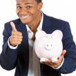 Closeup portrait of rich super excited young successful happy man introducing his friend, the piggy bank — Stock Photo #37405507