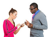 Closeup portrait of woman checking cell phone of her man, finding out he is texting other ladies and cheating — Stock Photo
