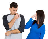 Closeup portrait of woman closing her nose, something stinks, very bad smell, odor. Guy sniffs himself — Stockfoto