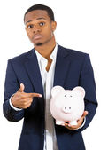 Closeup portrait of rich young successful man introducing his friend, the piggy bank — Stock Photo