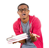 Closeup of a young handsome man, wearing big glasses, holding books, anxious in anticipation of finals, exam test — Foto Stock