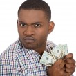 Closeup portrait of greedy mcorporate employee, worker, student holding dollar banknotes tightly — Stock Photo #37754891