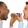 Closeup portrait of two men yelling screaming shouting on opposite ends of phone — Stock Photo