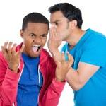Closeup portrait of guy whispering into man's ear telling him something secret and disturbing — Stock Photo