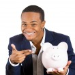 Closeup portrait of rich super excited young successful happy man introducing his friend, the piggy bank — Stock Photo