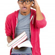 Closeup of young handsome man, wearing big glasses, holding books, anxious in anticipation of finals, exam test — Stock Photo #37756277