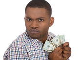 Closeup portrait of greedy man corporate employee, worker, student holding dollar banknotes tightly — Stock Photo