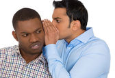 Closeup portrait of guy whispering into man's ear telling him something secret and disturbing — Stock Photo