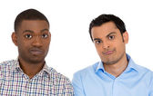 Closeup portrait of skeptical young men looking at camera with suspicion and disgust on face, mixed with disapproval — Stock Photo